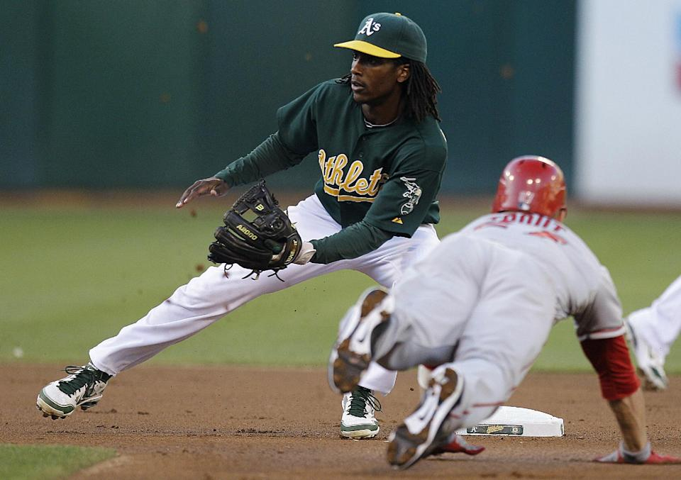 Los Angeles Angels' Mike Trout, right, steals second base as Oakland Athletics' Jemile Weeks waits for the ball in the first inning of a baseball game, Monday, Aug. 6, 2012, in Oakland, Calif. (AP Photo/Ben Margot)
