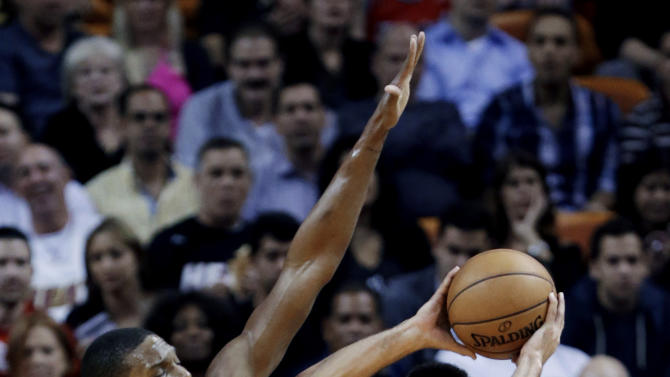 Charlotte Bobcats guard Jeffery Taylor (44) of Sweden, looks for an open teammate past Miami Heat center Chris Bosh (1) during the first half of an NBA basketball game, Monday, Feb. 4, 2013 in Miami. (AP Photo/Wilfredo Lee)