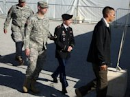 File picture shows US Army Private Bradley Manning (2nd R) being escorted to court at Fort Meade, Maryland. Lawyers for Manning, charged with passing a trove of classified documents to WikiLeaks, accused the military Tuesday of withholding hundreds of emails over fears of a publicity nightmare