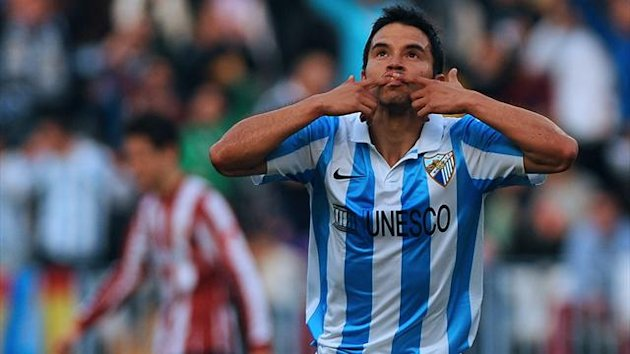 SPAIN, Málaga : Malaga's Argentinian forward Javier Saviola celebrates after scoring during the Spanish league football match Malaga CF vs Athletic Bilbao at the Rosaleda stadium in Malaga on February 16, 2013. AFP