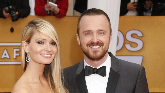 Lauren Parsekian and Aaron Paul arrive at the 19th Annual Screen Actors Guild Awards at the Shrine Auditorium in Los Angeles on Sunday Jan. 27, 2013. (Photo by Todd Williamson/Invision for The Hollywood Reporter/AP Images)