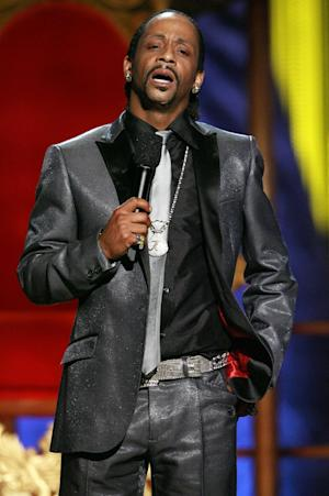 """In this Sunday, July 22, 2007 photo, Katt Williams performs onstage during the """"Comedy Central Roast of Flavor Flav,"""" in Burbank, Calif. Williams found himself on the wrong side of the law after being arrested in Los Angeles, Friday, Dec. 28, 2012, on suspicion of child endangerment and possession of a stolen gun. Police Officer Norma Eisenman says Williams was taken into custody Friday after the Los Angeles County Department of Children and Family Services did a welfare check at his home. Authorities found more than one firearm, one of which had been reported stolen. (AP Photo/Matt Sayles)"""