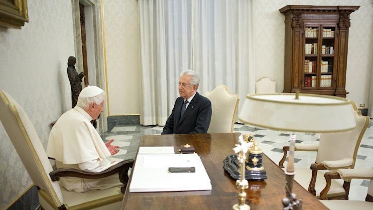 FILE -- In this photo from files taken on Feb. 16, 2013 and released by the Vatican newspaper L'Osservatore Romano, Pope Benedict XVI meets with Italian Premier Mario Monti during a private audience at the Vatican. The Vatican traditionally wields influence on Italy's politics and the visit during the electoral campaign raised questions on how much political weight an endorsement from a lame-duck pope might carry in the upcoming Italian general elections where Monti is running for premier. (AP Photo/L'Osservatore Romano, ho)