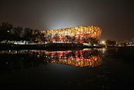 BEIJING, CHINA - MAY 21:  The night scene of National Stadium, also known as Bird's Nest, is seen during 2013 IAAF World Challenge Beijing on May 21, 2013 in Beijing, China. Beijing won the bid to host the 2015 IAAF World Championships in Athletics in 2010, and accordingly it will organize the world challenge games in 2013 and 2014 respectively.  (Photo by Feng Li/Getty Images)