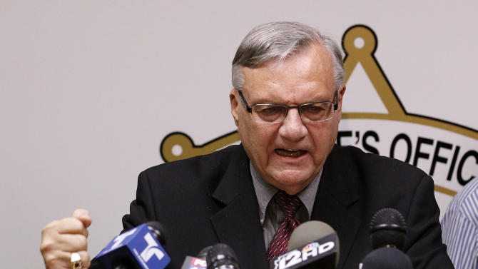 FILE - In this May 10, 2012 file photo, Maricopa County Sheriff Joe Arpaio pounds his fist on the podium during a news conference in Phoenix as he answers questions regarding the Department of Justice's federal civil lawsuit against him and his department. Arpaio, known nationally for his hardline stance on illegal immigration, is expected to take the witness stand Tuesday, July 24, 2012 and face allegations that his trademark immigration sweeps amounted to racial profiling against Hispanics. (AP Photo/Ross D. Franklin, File)