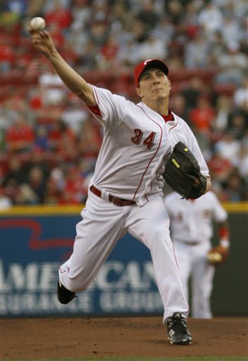 Cardinals hit 3 HRs in 1st, beat Reds 7-1