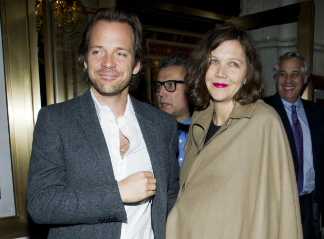 "FILE - In this March 15, 2012 file photo, actors Peter Sarsgaard amd Maggie Gyllenhaal  leave the opening night performance of the Broadway revival of Arthur Miller's ""Death of a Salesman"" in New York"
