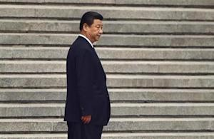 China's President Xi Jinping waits for his Palestinian counterpart Mahmoud Abbas before a welcoming ceremony outside the Great Hall of the People in Beijing