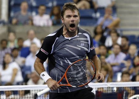 Stan Wawrinka of Switzerland celebrates after defeating Thomaz Bellucci of Brazil during their match at the 2014 U.S. Open tennis tournament in New York