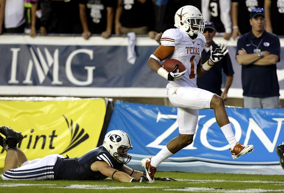 Brigham Young defensive back Skye PoVey, left, falls as Texas wide receiver Mike Davis (1) scores in the first quarter during an NCAA college football game, Saturday, Sept. 7, 2013, in Provo, Utah. (AP Photo/Rick Bowmer)