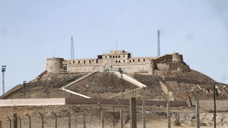 The Ottoman-era fortress overlooking Sebha, Libya on Sept. 22, 2014, which is often fought over by rival militias. In the rocky mountains and dune-covered wastes of southwestern Libya, al-Qaida's North African branch has established a haven and is now restocking weapons and mining disaffected minorities for new recruits as it prepares to relaunch attacks. (AP/Paul Schemm).