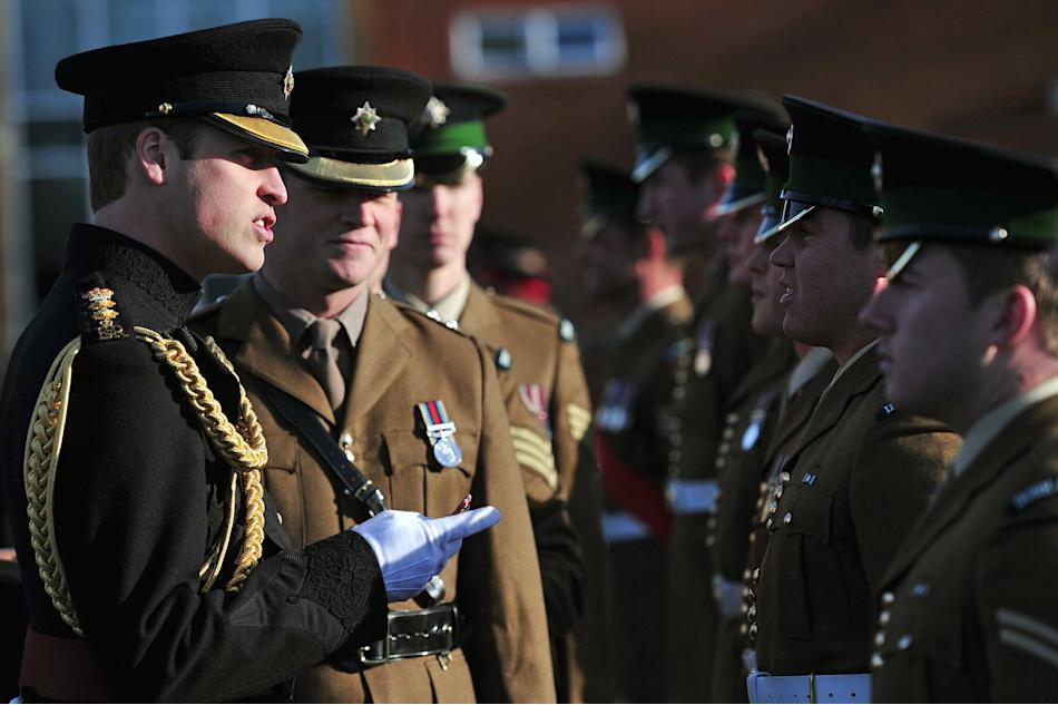 Britain's Prince William presents operational service medals for deployment in Afghanistan to soldiers during a ceremony at their barracks in Aldershot, southern England