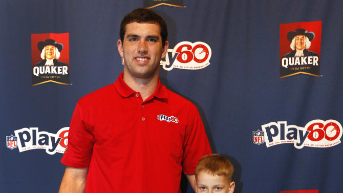 Indianapolis Colts quarterback Andrew Luck and Hunter Paulin, winner of the NFL Play 60 Super Bowl Contest presented by Quaker,  pose for a photo at the Quaker's NFL Experience in New Orleans on Wednesday, Jan. 30, 2013. (Jonathan Bachman / AP Images for Quaker Oats)