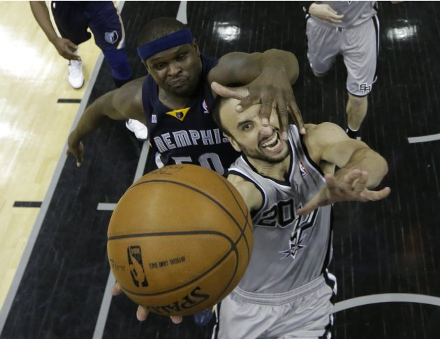San Antonio Spurs guard Manu Ginobili shoots against Memphis Grizzlies forward Zach Randolph during their NBA basketball game in San Antonio, Texas