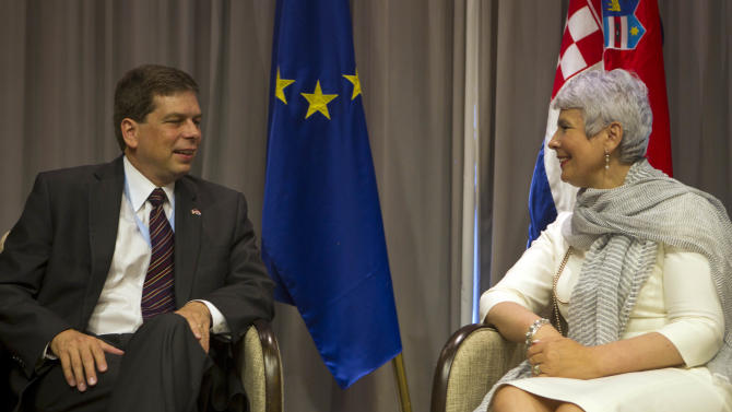 U.S. senator Mark Begich, D. AK, left, talks with Croatian prime minister Jadranka Kosor at the Croatia Summit in Dubrovnik, Croatia, Saturday, July 9, 2011. The Croatia Summit is an annual international conference held since 2006 which focuses on southeastern Europe. (AP Photo/Darko Bandic)