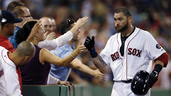 Boston Red Sox's Jonny Gomes, right, celebrates his solo home run in the fifth inning of a baseball game against the New York Yankees in Boston, Sunday, July 21, 2013. (AP Photo/Michael Dwyer)