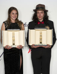 Actors Shailene Woodley, left and Ezra Miller, with their Chopard trophies, during the Chopard Trophy awards ceremony at the 65th international film festival, in Cannes, southern France, Thursday, May 17, 2012. (AP Photo/Jonathan Short)