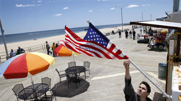 Thomas Bodary, of Spring Lake, prepares to open Mayfair Boardwalk Grill on the boardwalk in Asbury Park, N.J., Sunday, May 26, 2013. The first summer season after Superstorm Sandy is underway at the Jersey shore, parts of which were devastated by the October storm. This is a brand-new Jersey Shore. While some recovery is still ongoing from Superstorm Sandy, the Jersey Shore to a very large extent has been cleaned up, rebuilt, reopened and is ready for business. (AP Photo/Mel Evans)