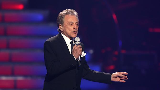 """FILE - In this May 16, 2013 file photo, Frankie Valli performs at the """"American Idol"""" finale at the Nokia Theatre at L.A. Live in Los Angeles. That trademark falsetto behind """"Sherry,"""" """"Big Girls Don't Cry"""" and other hits from 50 years ago will usher in the July 4 celebration on the National Mall this year as Frankie Valli headlines the """"Capitol Fourth"""" show in Washington. (Photo by Matt Sayles/Invision/AP, File)"""