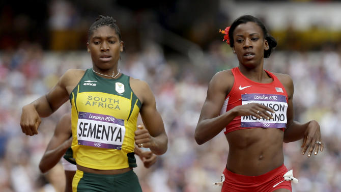 United States'  Alysia Johnson Montano and South Africa's Caster Semenya cross the  finish line in a women's 800-meter heat during the athletics in the Olympic Stadium at the 2012 Summer Olympics, London, Wednesday, Aug. 8, 2012. (AP Photo/Anja Niedringhaus)