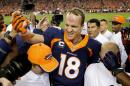 Denver Broncos quarterback Peyton Manning (18) celebrates his 509th career touchdown pass with teammates during the first half of an NFL football game against the San Francisco 49ers, Sunday, Oct. 19, 2014, in Denver. (AP Photo/Jack Dempsey)