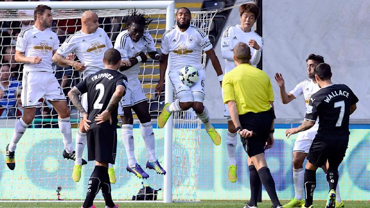 Swansea City's Williams stops a free-kick taken by Burnley's Wallace during their English Premier League soccer match at the Liberty Stadium in Swansea