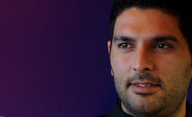 Indian cricketer Yuvraj Singh poses duri