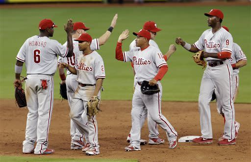 Win No. 200 for Halladay as Phils beat Marlins 2-1