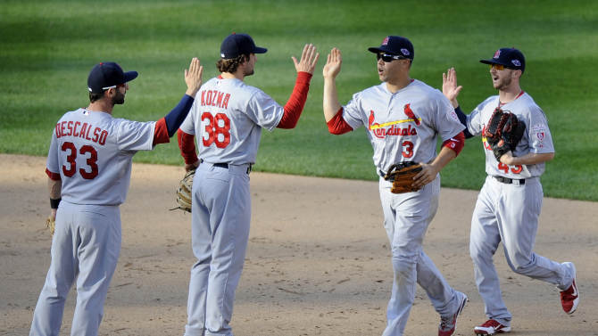 St. Louis Cardinals', from left, Daniel Descalso, Pete Kozma, Carlos Beltran and Shane Robinson high-five after Game 3 of the National League division baseball series against the Washington Nationals on Wednesday, Oct. 10, 2012, in Washington. St. Louis won 8-0. (AP Photo/Nick Wass)