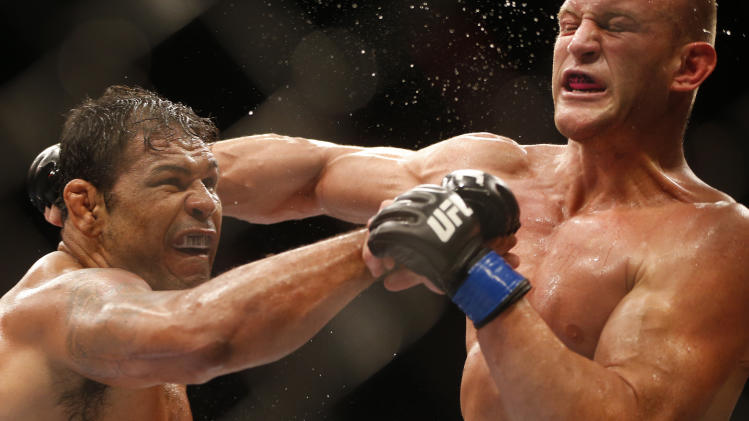 Minotauro Nogueira, left, from Brazil, left, fights Dave Herman, from the United States, during their heavyweight mixed martial arts bout at UFC 153 in Rio de Janeiro, early Sunday, Oct. 14, 2012. Nogueira defeated Herman. (AP Photo/Felipe Dana)