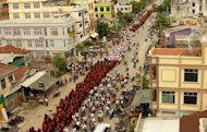 Myanmar Buddhist monks rally on the streets of Mandalay. Hundreds of Buddhist monks marched in Myanmar Sunday to support President Thein Sein&#39;s suggestion that Muslim Rohingya be deported or held in camps, in the biggest rally since the end of junta rule