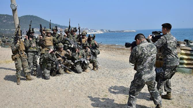US and South Korean Marines pose for a photo during a joint landing drill, in the southeastern port of Pohang, on March 30, 2015