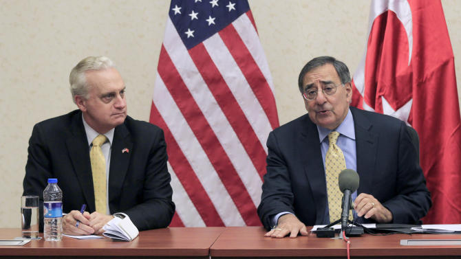 FILE - In this Dec. 16, 2011, file photo, Defense Secretary Leon Panetta, right, and U.S. Ambassador to Turkey Francis Ricciardone, take part in a news conference in Ankara, Turkey. When he was ambassador to Egypt, Ricciardone wrote in a secret State Department memo in March 2008 that Egyptian Minister for International Cooperation Fayza Aboulnaga continued to complain about U.S. money for unlicensed democracy groups that trained political activists. Ricciardone was worried that the groups, which he called partners, could be targeted by the minister, who opposed the U.S. financing of the groups unless the money went through her office. Two months before Egyptian police stormed the offices of U.S.-backed democracy organizations in 2011, seven Egyptian employees resigned from one of the American groups to protest what they called very undemocratic practices. Their complaints: The U.S. group described as nonpartisan had excluded the country's most popular Islamist political organization from its programs, collected sensitive religious information about Egyptians when conducting polls to send to Washington, and ordered employees to erase all computer files and turn over all records for shipment abroad months before the raids. (AP Photo/Pablo Martinez Monsivais, Pool)