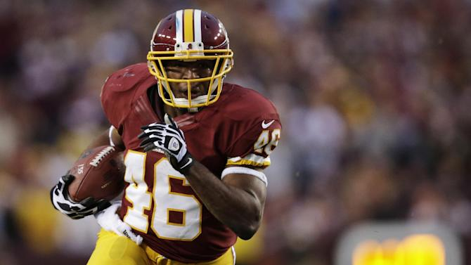 Washington Redskins running back Alfred Morris carries the ball during the first half of an NFL wild card playoff football game against the Seattle Seahawks in Landover, Md., Sunday, Jan. 6, 2013. (AP Photo/Evan Vucci)