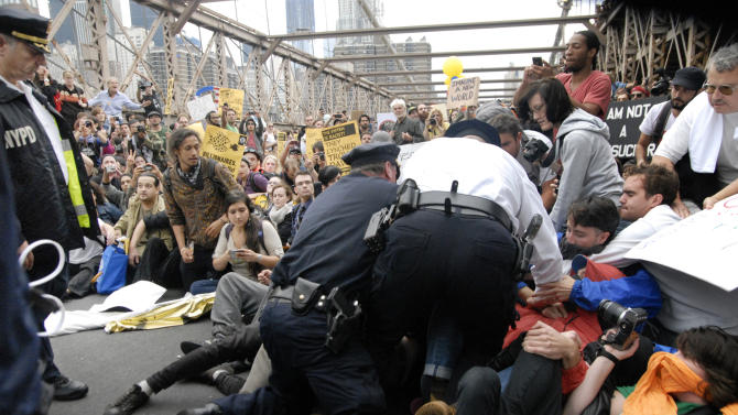 FILE - In this Oct. 1, 2011 file photo, police arrest protesters on New York's Brooklyn Bridge during march by Occupy Wall Street. Twitter agreed on Friday, Sept. 14, 2012, to hand over about three months' worth of tweets to a judge overseeing the criminal trial of Malcolm Harris, an Occupy Wall Street protester, a case that has become a closely watched fight over how much access law enforcement agencies should have to material posted on social networks. (AP Photo/Stephanie Keith, File)