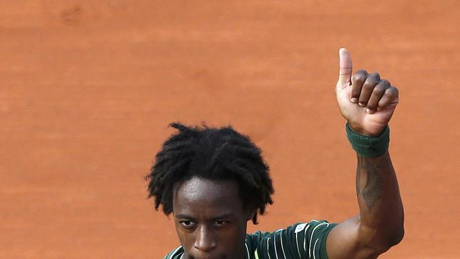 Gael Monfils of France celebrates after beating compatriot Edouard-Roger Vasselin during their men's singles match at the French Open tennis tournament at the Roland Garros stadium in Paris