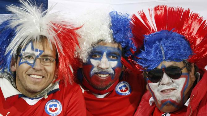 Chile fans await the start of the team's Copa America 2015 semi-final soccer match against Peru at the National Stadium in Santiago