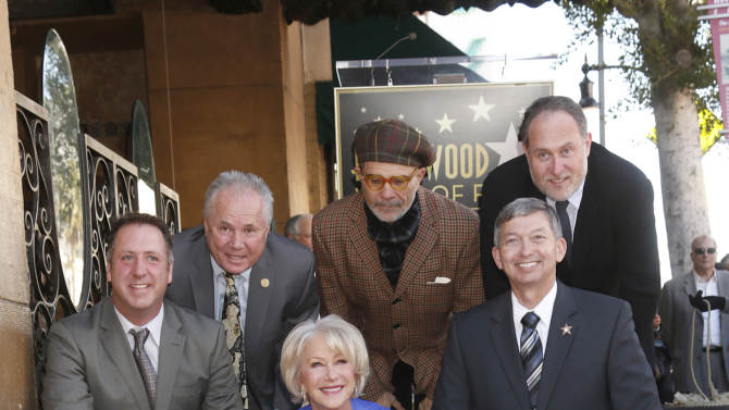 Helen Mirren unveils her star on the Hollywood walk of Fame with Taylor Hackford, Tom LaBonge, David Mamet, Jon Turtletaub and Leron Gubler  January 3, 2013 in Hollywood, California.  (Photo by Todd Williamson/Invision for Fox Searchlight/AP Images)