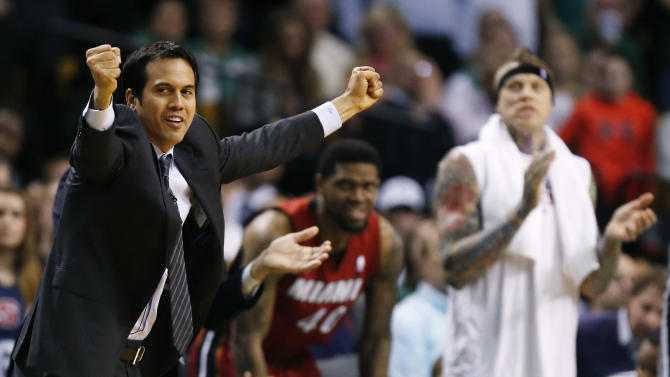 Miami Heat head coach Erik Spoelstra, left, reacts to play in the fourth quarter of an NBA basketball game against the Boston Celtics in Boston, Monday, March 18, 2013. The Heat won 105-103. (AP Photo/Michael Dwyer)
