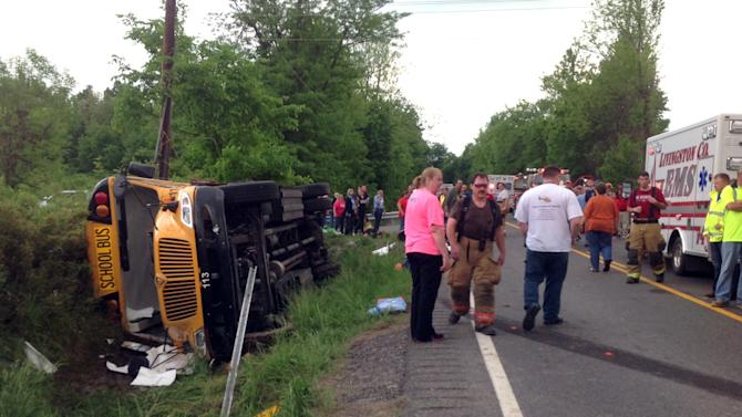 In this photo provided by the Kentucky Transportation Cabinet, emergency crews respond to the scene of an overturned Union County school bus on U.S. 60 at Silver Mine Road near Smithland, Ky., Friday, May 10, 2013. The bus was carrying the Union County High School girls' softball team and had 28 people aboard when it overturned. 25 of those on board were taken to local hospitals with non-life threatening injuries. State Police Trooper Richie Wright said one patient was airlifted from the scene, but it was not due to serious injuries. (AP Photo/Kentucky Transportation Cabinet)