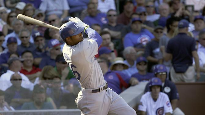 Los Angeles Dodgers' Yasiel Puig hits a three-run home run off Chicago Cubs relief pitcher Dan Straily, also scoring A.J. Ellis and Dee Gordon, during the sixth inning of a baseball game Friday, Sept. 19, 2014, in Chicago. (AP Photo/Charles Rex Arbogast)