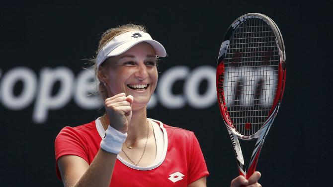 Makarova of Russia celebrates defeating Goerges of Germany to win their women's singles match at the Australian Open 2015 tennis tournament in Melbourne