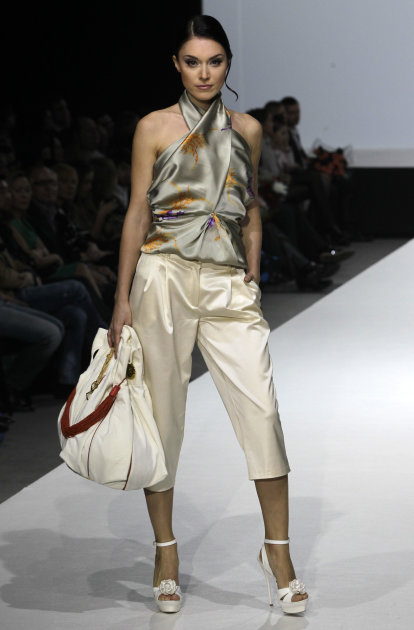 A model displays a creations by Russian designer Alina Assi during the Volvo Fashion Week in Moscow, Russia, Saturday, Oct. 29, 2011. (AP Photo/Misha Japaridze)