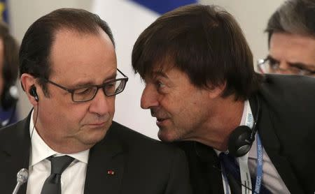 "French President Hollande speaks with French environmental activist Hulot during ""The Climate Challenge and African solutions"" event during the World Climate Change Conference 2015 at Le Bourget"
