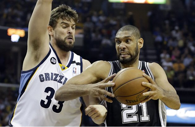San Antonio Spurs forward Tim Duncan (21) drives to the basket as Memphis Grizzlies center Marc Gasol (33) defends, during Game 4 of the Western Conference finals NBA basketball playoff series in Memp