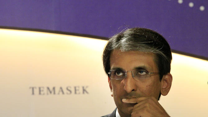 Dilhan Pillay, portfolio management head of Temasek Holdings, answers questions from the media on Thursday, July 5, 2012, in Singapore. Singapore state investment company Temasek Holdings said growth in the value of its investments slowed in the last financial year as a weakening global economy undermined the value of Asian companies.(AP Photo/Wong Maye-E)