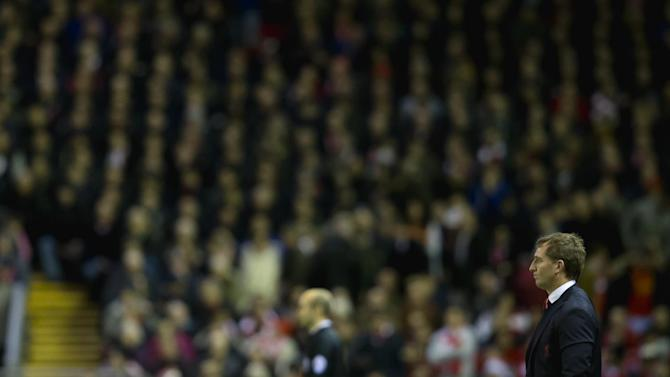 Liverpool's manager Brendan Rodgers looks on as his team draw 2-2 during the English Premier League soccer match between Liverpool and Arsenal at Anfield Stadium, Liverpool, England, Sunday Dec. 21, 2014. (AP Photo/Jon Super)