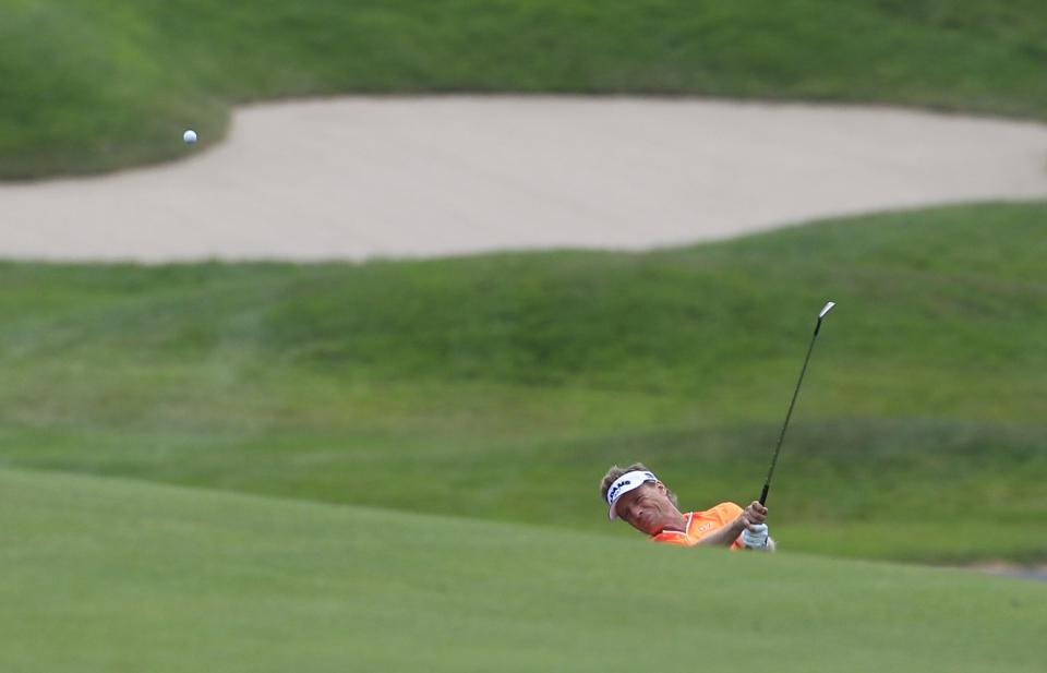 Bernhard Langer hits his approach shot on the eighth hole during the third round at the U.S. Senior Open golf tournament at the Indianwood Golf and Country Club in Lake Orion, Mich., Saturday, July 14, 2012. (AP Photo/Carlos Osorio)