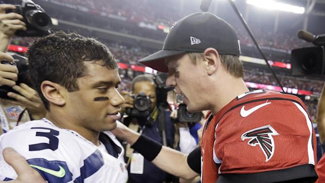 Atlanta Falcons quarterback Matt Ryan (2) speaks to Seattle Seahawks quarterback Russell Wilson (3) after the second half of an NFC divisional playoff NFL football game Sunday, Jan. 13, 2013, in Atlanta. The Falcons won 30-28. (AP Photo/David Goldman)