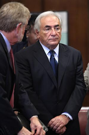 FILE - In this Monday, June 6, 2011 file photo, former IMF leader Dominique Strauss-Kahn, right, appears at his arraignment on charges of sexually assaulting a Manhattan hotel maid, at State Supreme Court in New York. Attorney William Taylor is at left.  A person familiar with the case says former International Monetary Fund Leader Dominique Strauss-Kahn will have his bail substantially reduced in his sexual assault case because of issues with his accuser's credibility, Thursday, June 30, 2011.  (AP Photo/Allan Tannenbaum, Pool, File)
